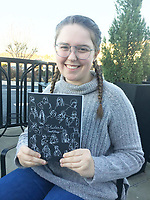 NWA Democrat-Gazette/DAVE PEROZEK Sarah Treacy, a senior at Rogers High School, holds a copy of her book, Students, which provides insight into the lives of 114 of her classmates through interviews and photographs. The book is available through Amazon.com.