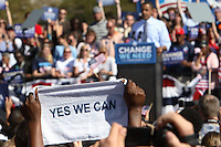 Supporters hold up signs as  Democratic presidential candidate Barack Obama speaks during his American Jobs Tour Rally at Genoa Park in Columbus, Ohio, on Friday, Oct. 10, 2008. (Kevin Craiglow/pressphotointl.com)