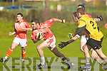 Tom Fitzgerald of Brosna breaks away from Asdee's Brian O'Hanlon and Eoin O'Carroll.