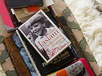 Nicky Haslam's memoirs lying casually on a pile of books in the living room