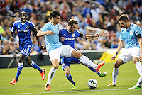 Juan Mata (10) Chelsea tackled by Manchester City defender Karim Rekik.Manchester City defeated Chelsea 4-3 in an international friendly at Busch Stadium, St Louis, Missouri.
