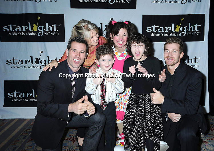 Austin Peck, Terri Conn, Hug-A-Me and Josh Kelly and kids attending the 26th Annual Starlight Children's Foundation Gala on March 16, 2011 at The Marriott Marquis Hotel in New York City.