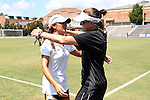 21 August 2016: UCF head coach Tiffany Roberts Sahaydak (left) and Duke assistant coach Carla Overbeck (right) embrace before the game. The Duke University Blue Devils played the University of Central Florida Knights in a 2016 NCAA Division I Women's Soccer match. Duke won the game 3-1.