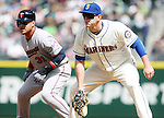 Minnesota Twins Oswaldo Arcia (31) takes a lead off from first base as Seattle Mariners'  first baseman Logan Morrrison guards the bag April 26, 2015 at Safeco Field in Seattle.  The Twins beat the Mariners beat the Angels 4--2. ©2015. Jim Bryant photo. All RIGHTS RESERVED.