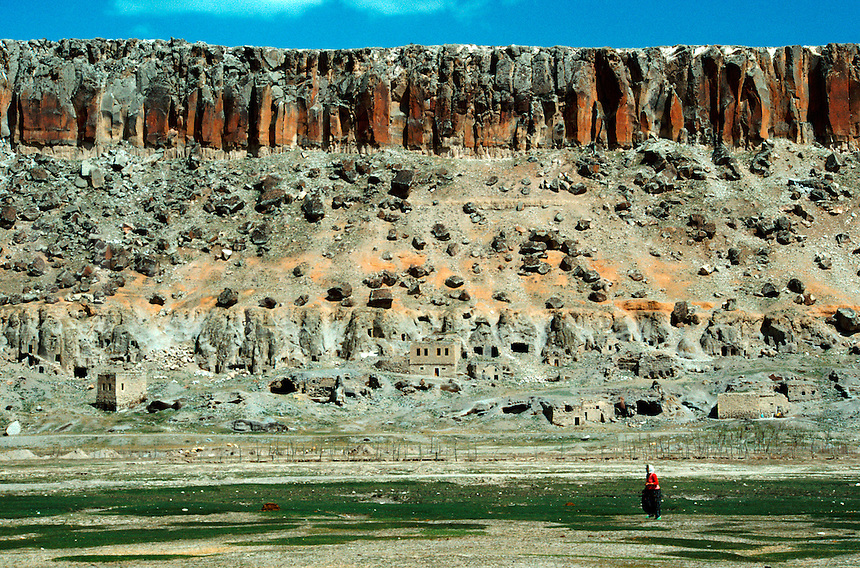 .Turkish girl in red sweater in rocky landscape, near Guzelyurt, central Anatolia, Turkey...