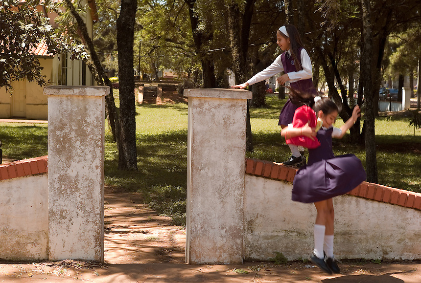 School girls play on the main church square at San Ignacio Guazu, Paraguay, the site of the oldest of scores of Jesuit missions in the area where Paraguay, Argentina and Brazil meet. The missions were built in the 17th century and abandoned when the Jesuits were expelled in the 18th century. Ruins of some of these missions still haunt hilltops in the region. (Kevin Moloney for the New York Times)