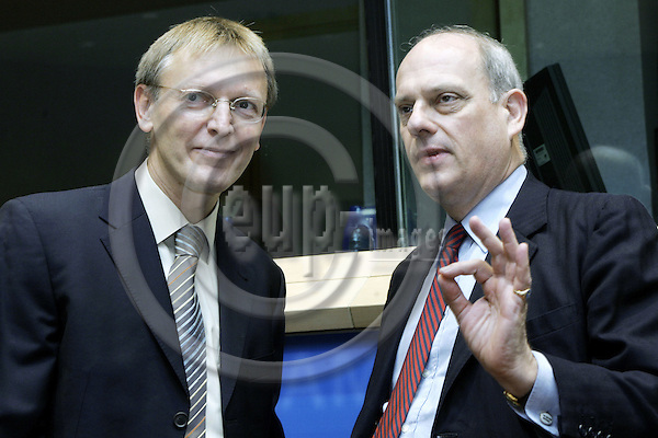 BRUSSELS - BELGIUM - 01 OCTOBER 2004 -- The EU-Parliament Hearing of EU-Commissioner Designate Janez POTOCNIK (L) (Slovenia) responsible for Science and Research with MEP Giles Bryan CHICHESTER (PPE-DE/GB) before the start of the hearing.-- PHOTO: JUHA ROININEN / EUP-IMAGES
