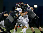 SIOUX FALLS, SD - SEPTEMBER 23: Kyle Campiotti  #19 and Joey Wehrkamp #54 from the University of Sioux Falls meet a quarterback Jeremy Neuman #14 from Minnesota Crookston in the first half of their game Saturday night at Bob Young Field in Sioux Falls. (Photo by Dave Eggen/Inertia)