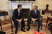 United States President George W. Bush meets with Bill Simon, Republican gubernatorial candidate from California, in the Oval Office of the White House in Washington, DC, April 10, 2002.<br /> Mandatory Credit: Paul Morse / White House via CNP