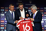 Atletico de Madrid's new player Hector Herrera (c) with the General Manager, Andrea Berta (l) and the President Enrique Cerezo during his official presentation. July 4, 2019. (ALTERPHOTOS/Acero)