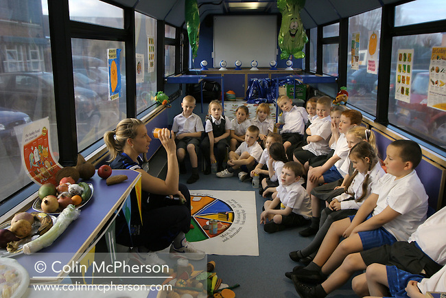 A day in the life of Football in the Community: Everton staff take part in daily activities in the local community. Picture shows England international goalkeeper Rachel Brown talking about foods and diet with a group of year 3 pupils at  Our Lady & St. Philomena's Catholic primary school in Fazakerly, as part of a touring Healthy Bus initiative run by the club.