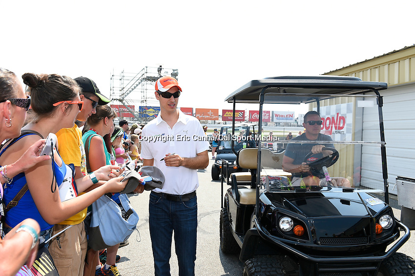 July 13, 2014 - Loudon, New Hampshire, U.S. - Sprint Cup Series driver Joey Logano (22) signs autographs for fans before the driver's meeting at  the NASCAR Sprint Cup Series Camping World RV 301 race held at the New Hampshire Motor Speedway in Loudon, New Hampshire. Eric Canha/CSM