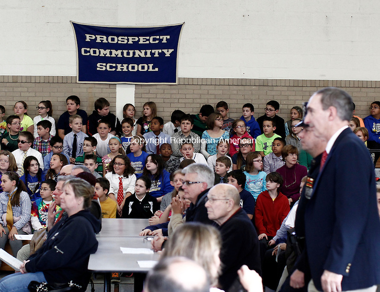 Prospect, CT- 15 November 2013-111513CM03-  Students at Community School in Prospect watch as elected town officials walk to be sworn in during a ceremony at the school Friday afternoon in Prospect.  Included in the swearing in is Mayor Robert J. Chatfield who is in his 19th term as mayor of the town of Prospect. Elected officials were sworn in during a ceremony at the school, a proceeding for the students as a lesson on civic government.    Christopher Massa Republican-American