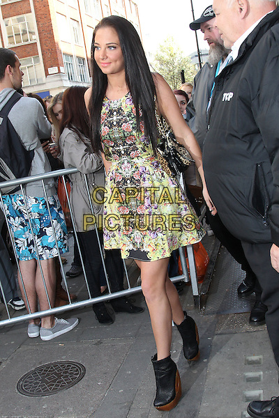 Tulisa Contostavlos at the studios of BBC Radio 1, London, England..April 2nd, 2012.full length yellow purple red floral print dress leopard print bag purse black ankle boots shoes wood wooden heel platform fans   .CAP/HIL.©John Hillcoat/Capital Pictures .