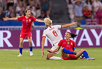 LYON,  - JULY 2: Millie Bright #6 fouls Alex Morgan #13 during a game between England and USWNT at Stade de Lyon on July 2, 2019 in Lyon, France.
