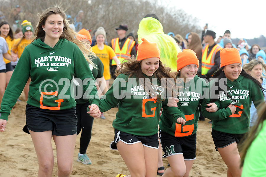 Members of Maywood's field hockey team run towards the water during the Polar Bear Plunge benefiting Special Olympics Saturday, January 27, 2017 at Neshaminy State Park in Bensalem, Pennsylvania. (Photo by William Thomas Cain)