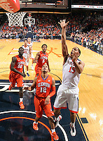 Virginia guard Malcolm Brogdon (15) shoots in front of Clemson guard Avry Holmes (12) during an ACC basketball game Tuesday Jan. 19, 2016, in Charlottesville, Va. (Photo/Andrew Shurtleff)