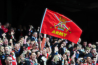 British Army supporters in the crowd celebrate a score. Babcock Inter-Services Championship match between the British Army and the Royal Navy on April 30, 2016 at Twickenham Stadium in London, England. Photo by: Patrick Khachfe / Onside Images