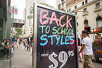 Back-to-school specials are advertised outside of a store in Herald Square in New York on Friday, August 1, 2014. Analysts are predicting a mediocre to poor back-to-school shopping season as retailers will be forced to heavily discount merchandise. The back-to-school shopping season is the second busiest time for retailers after Christmas. (© Richard B. Levine)