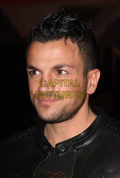 PETER ANDRE .Attends the Ed Hardy Store Launch Party at Westfield Shopping Centre, London, England, UK, .December 1st 2009..portrait headshot black leather beard facial hair stubble gold logo .CAP/JIL.©Jill Mayhew/Capital Pictures