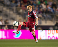 Jeff Larentowicz (20) of the Chicago Fire takes a first touch on the ball during a Major League Soccer match at PPL Park in Chester, PA.  Philadelphia defeated Chicago, 1-0.