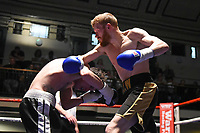Tommy Williams (black/gold shorts) defeats Scott Hillman during a Boxing Show at York Hall on 14th April 2018