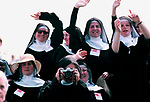 Nuns celebrating the Pope John Paul 2 visits Glasgow Scotland UK 1982. Huge crowd Roman Catholics attend the Pope travels in his Popemobile through Bellahouston Park 1980s