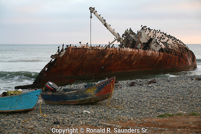 TWO PANGA BOATS on the BEACH WITH SHIP WRECKED BOAT FLOATING OFF the MEXICAN COAST in the BACKGROUND (3)