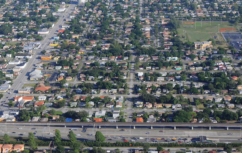 An aerial view of a Miami residential community, seen from the vantage point of an American Airlines Boeing 737 passenger jet