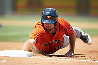 Jake Adams (30) of the Buies Creek Astros dives back towards first base during the game against the Winston-Salem Dash at BB&T Ballpark on July 15, 2018 in Winston-Salem, North Carolina. The Dash defeated the Astros 6-4. (Brian Westerholt/Four Seam Images)