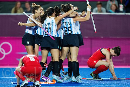 08 AUG 2012 - LONDON, GBR - Argentinian (ARG) players celebrate winning the London 2012 Olympic Games women's semi final match against Great Britain at the Riverbank Arena in the Olympic Park, Stratford, London, Great Britain (PHOTO (C) 2012 NIGEL FARROW)