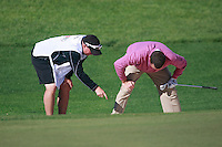 Anthony Wall (ENG) and caddy examine his ball a bunker at the 9th green during Sunday's Final Round of the Bankia Madrid Masters at El Encin Golf Hotel, Madrid, Spain, 9th October 2011 (Photo Eoin Clarke/www.golffile.ie)