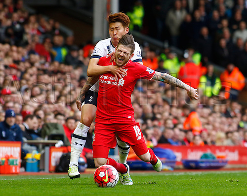 02.04.2016. Anfield, Liverpool, England. Barclays Premier League. Liverpool versus Tottenham Hotspur.  Liverpool defender Alberto Moreno is brought down by Spurs striker Son Heung-Min.