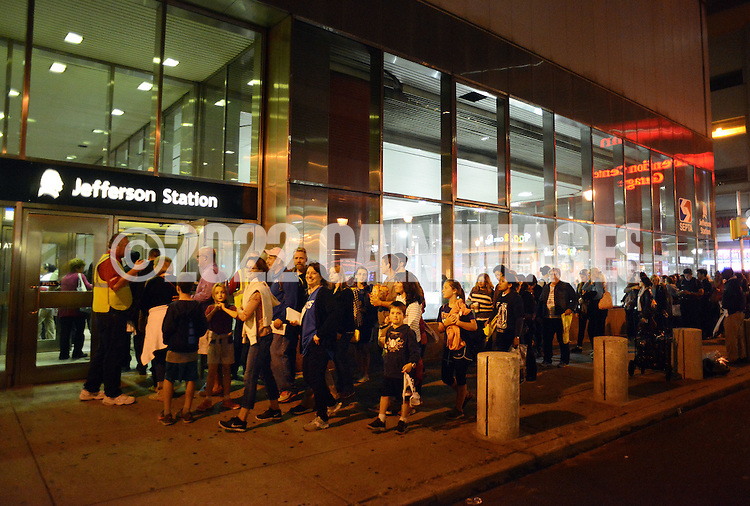 Pilgrims head home Fort Washington Station via Septa Regional Rail after the Papal Mass celebrated by Pope Francis Benjamin Franklin Parkway Sunday September 27, 2015 in Philadelphia, Pennsylvania.  (Photo By William Thomas Cain)