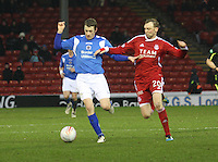Scott McLaughlin being closed down by Stephen Hughes in the Aberdeen v Queen of the South William Hill Scottish Cup 5th Round match played at Pittodrie Stadium, Aberdeen on 4.2.12...