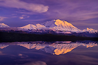 Mount McKinley reflecting in a quiet, small lake found between Eielson and Wonder Lake, Denali National Park.  Summer sunset..