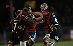 Munster lock Paul O'Connell crashes into the Dragons defence of Nic Cudd, Netani Talei and Cory Hill.<br /> RaboDirect Pro12<br /> Newport Gwent Dragons v Munster<br /> Rodney Parade - Newport<br /> 29.11.13<br /> ©Steve Pope-SPORTINGWALES
