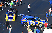 Apr. 14, 2012; Concord, NC, USA: NHRA funny car driver Ron Capps returning to the pits during qualifying for the Four Wide Nationals at zMax Dragway. Mandatory Credit: Mark J. Rebilas-