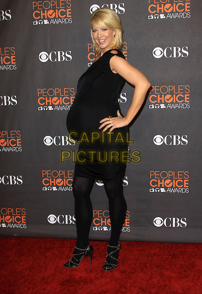 JENNA ELFMAN .People's Choice Awards 2010 held At Nokia Theatre LA LiVE, .Los Angeles, California, USA, .6th January 2010..arrivals full length pregnant maternity black dress one shoulder tights sandals hand on hip  side .CAP/ADM/KB.©Kevan Brooks/Admedia/Capital Pictures