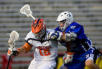 John Haldy (12) of Virginia is checked by Sam Payton (32) of Duke during the ACC men's lacrosse tournament semifinals in College Park, MD.  Virginia defeated Duke, 16-12.