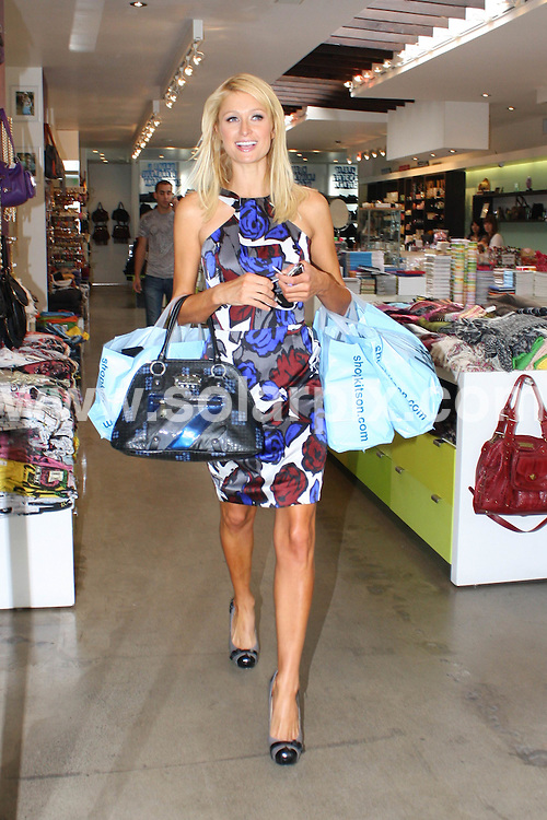 **ALL ROUND PICTURES FROM SOLARPIX.COM**.**WORLDWIDE SYNDICATION RIGHTS**.**NO PUBLICATION IN AUSTRALIA, NEW ZEALAND, DENMARK, GERMANY OR USA**.Paris Hilton goes shopping at Kitson in Beverly Hills and immediately swarmed by young male fans during her exit. Beverly Hills, California, USA. 29th September 2008..JOB REF: 7489 LAP(HD)      DATE: 29_09_2008.**MUST CREDIT SOLARPIX.COM OR DOUBLE FEE WILL BE CHARGED* *UNDER NO CIRCUMSTANCES IS THIS IMAGE TO BE REPRODUCED FOR ANY ONLINE EDITION WITHOUT PRIOR PERMISSION*