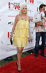 "Actress Tori Spelling arrives at the Much Love Animal Rescue Presents The Second Annual ""Bow Wow WOW!"" at The Playboy Mansion on July 19, 2008 in Beverly Hills, California."