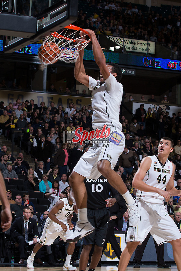 Devin Thomas (2) of the Wake Forest Demon Deacons follows through on a slam dunk during first half action against the Xavier Musketeers at the LJVM Coliseum on December 22, 2015 in Winston-Salem, North Carolina.  The Musketeers defeated the Demon Deacons 78-70.  (Brian Westerholt/Sports On Film)