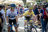yellow jersey / GC leader Julian Alaphilippe (FRA/Deceuninck - QuickStep) playing with (eventual stage winner) Matteo Trentin (ITA/Mitchelton-Scott) at the race start at the Pont du Gard<br /> <br /> Stage 17: Pont du Gard to Gap (206km)<br /> 106th Tour de France 2019 (2.UWT)<br /> <br /> ©kramon
