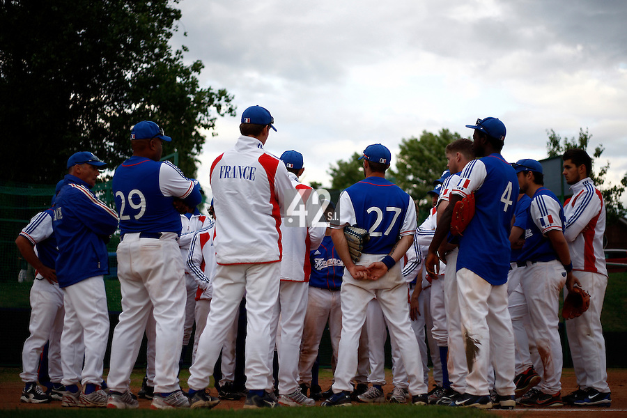 24 June 2011: Team France manager Fabien Proust talks to his players after France 8-5 win over UCLA Alumni, at the 2011 Prague Baseball Week, in Prague, Czech Republic.