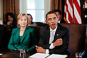 """Washington, DC - September 10, 2009 -- United States President Barack Obama flanked by Secretary of State Hillary Rodham Clinton attends a meeting with members of the Cabinet in the Cabinet Room,September 10, 2009 in Washington, DC. During the meeting President Obama said he accepts the apology of Congressman Joe Wilson (R-S.C.) for yelling out """"You Lie"""" during Obama's speech on healthcare reform to a joint session of Congress..Credit: Olivier Douliery - Pool via CNP"""