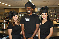 NWA Democrat-Gazette/CARIN SCHOPPMEYER Tania Hernandez (from left), Abdul Muhammed and Karen Macias, Brightwater culinary students, give tours of the school's pastry kitchen during Plant a Seed.