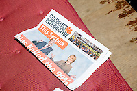 A Socialist Alternative newspaper featuring Trump and Clinton rests on a seat before Green Party presidential nominee Jill Stein speaks at a campaign rally at Old South Church in Boston, Massachusetts on Sun., Oct. 30, 2016.
