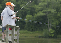 Cole Hillsamer (11), left, and Jared Timmons (11), both of Beaver Creek, fish from a dock during a fishing derby Saturday, June 11, 2005, in Bellbrook, Ohio.