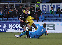 Antonio Reguero saves ahead of team mate Steven Saunders and Yoann Arquin in the Ross County v St Mirren Scottish Professional Football League match played at the Global Energy Stadium, Dingwall on 17.1.15.